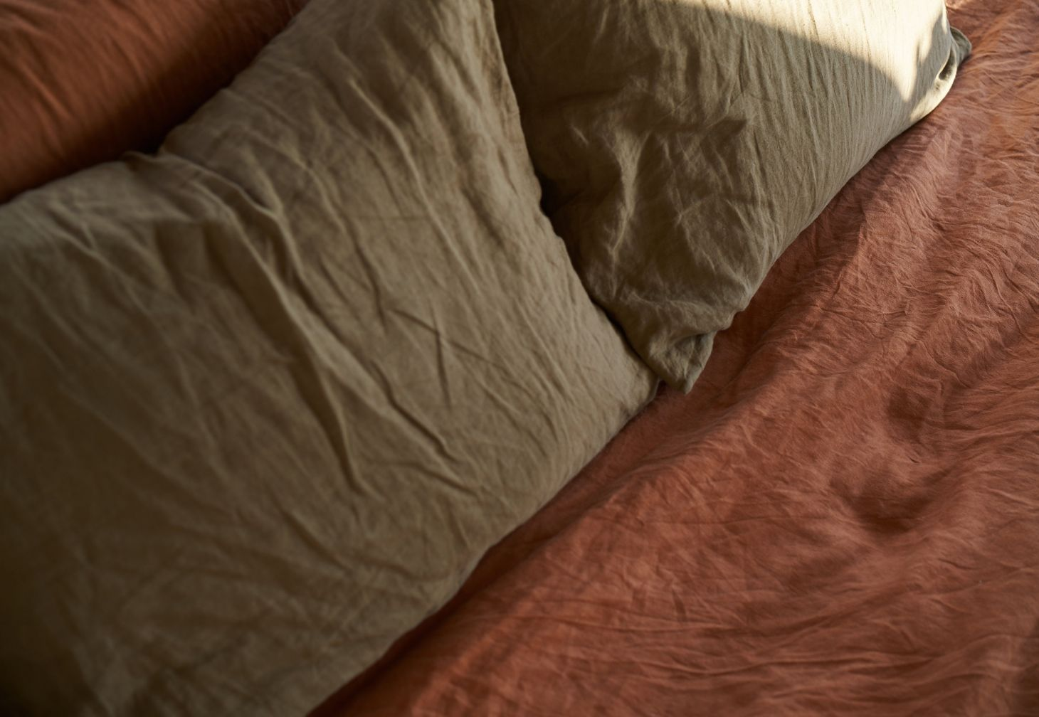 Linen duvet cover and linen pillow slips in tobacco and moss by IN BED x Triibe.
